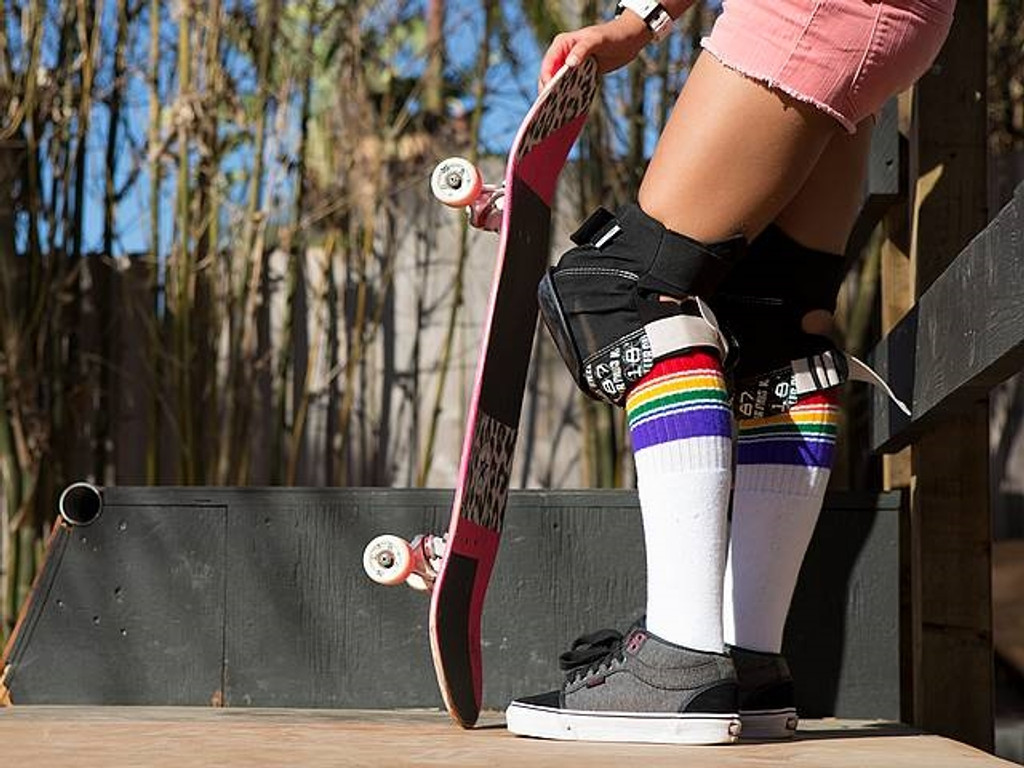 waiting for my turn to drop in the bowl.  i love wearing my pride socks when i skate