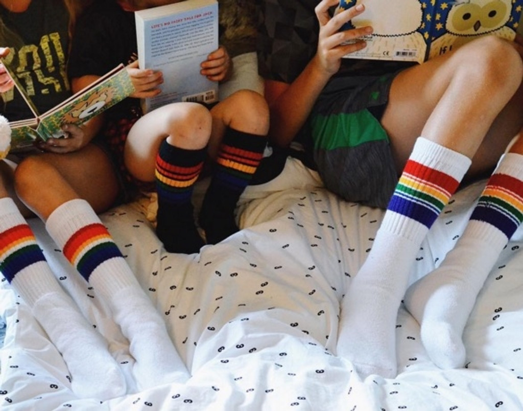 a family that wears the same pride socks, stays together