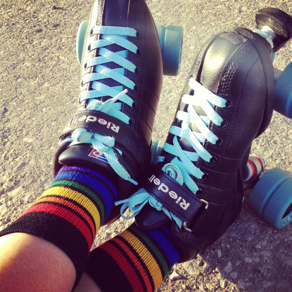 ready to skate- no problem.  our black rainbow striped athletic pride socks will show off all your glory.