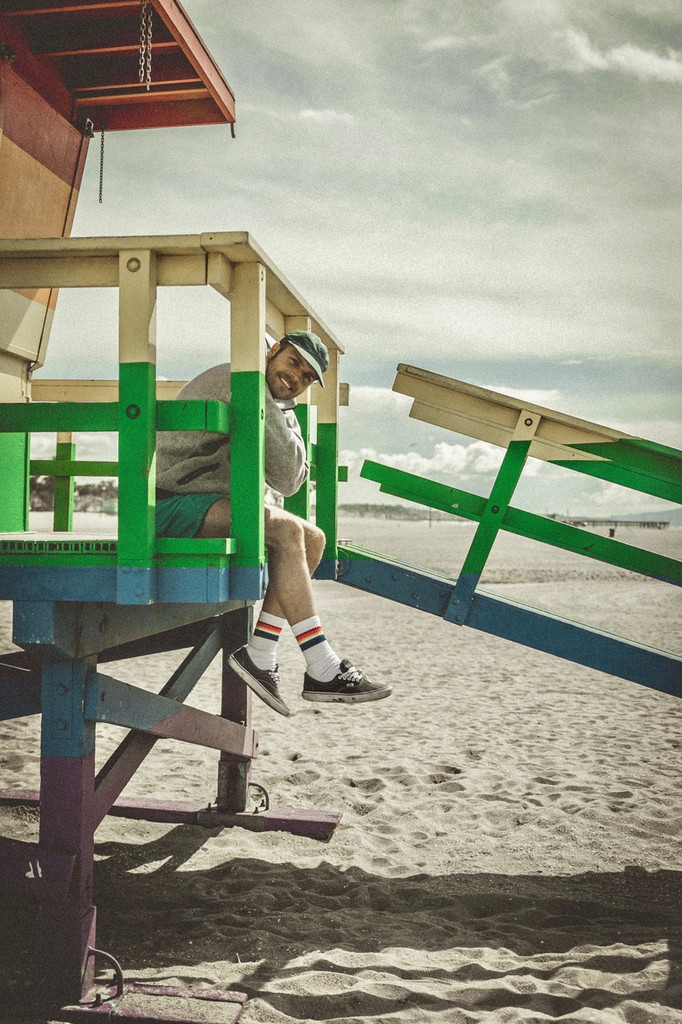 show the pride socks love when hanging out in venice beach, ca