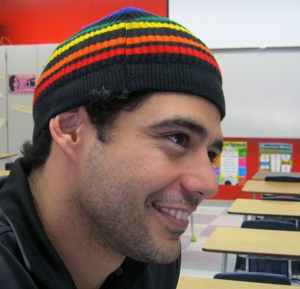 looking cool while wearing your pride socks black rainbow beanie