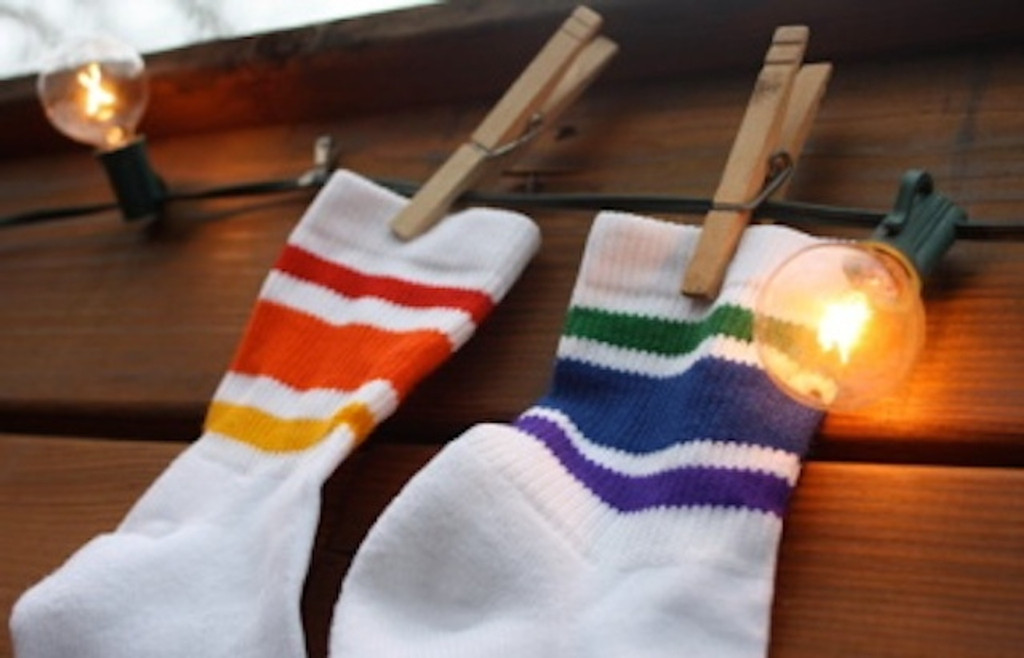 showing off your mismatch rainbow pride socks