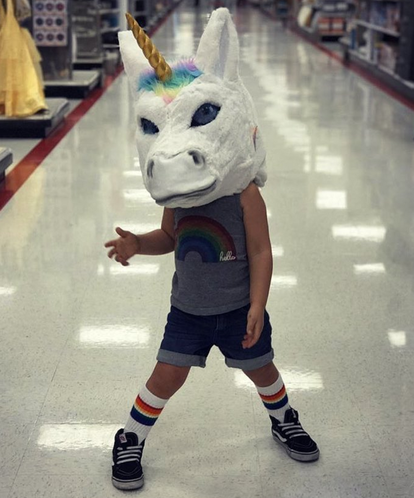 yeah i am pretty cool playing in target in my pride socks with this unicorn mask on