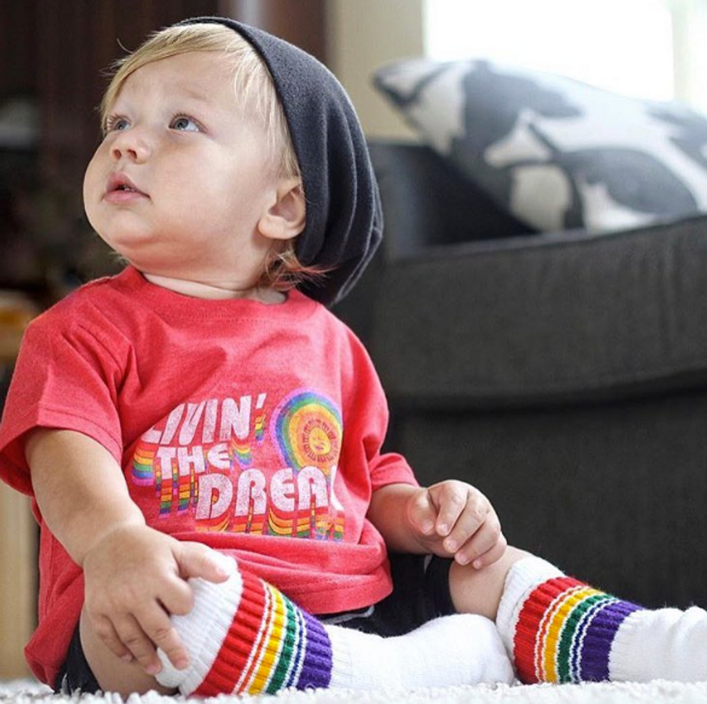 Livin the dream to the fullest in his pride socks gear and adventure toddler socks