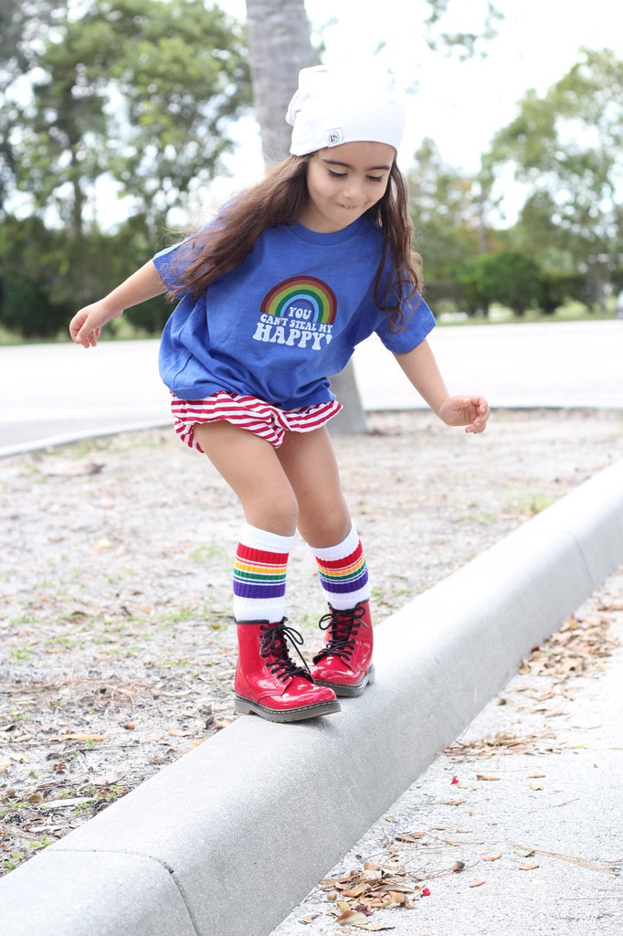 living life on the cliff.  pull up your adventure kid tube socks and let the wild side grow