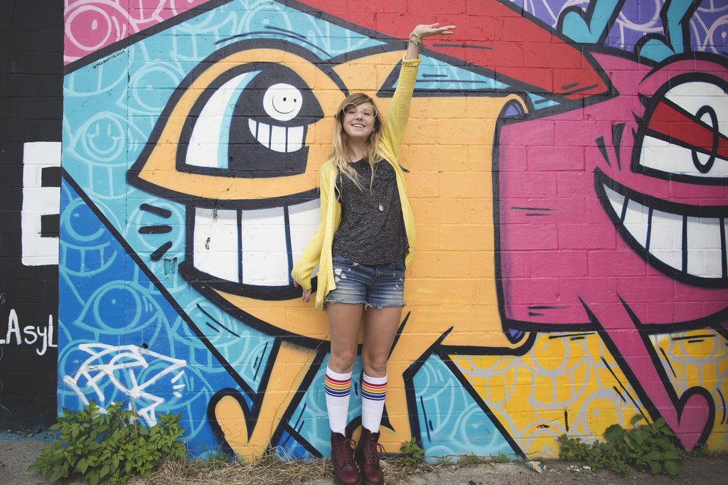 perfect photo shoot wearing my pride socks in my boots