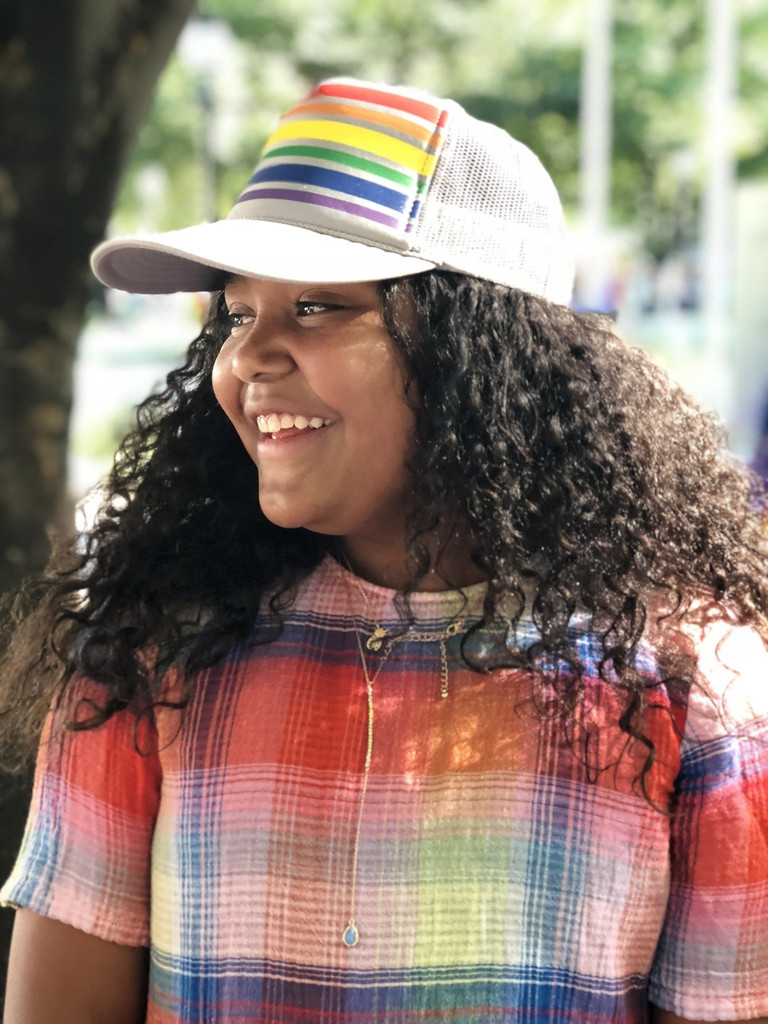 Our gray rainbow trucker pride socks hats are perfect when you have a lot of hair to hold back.