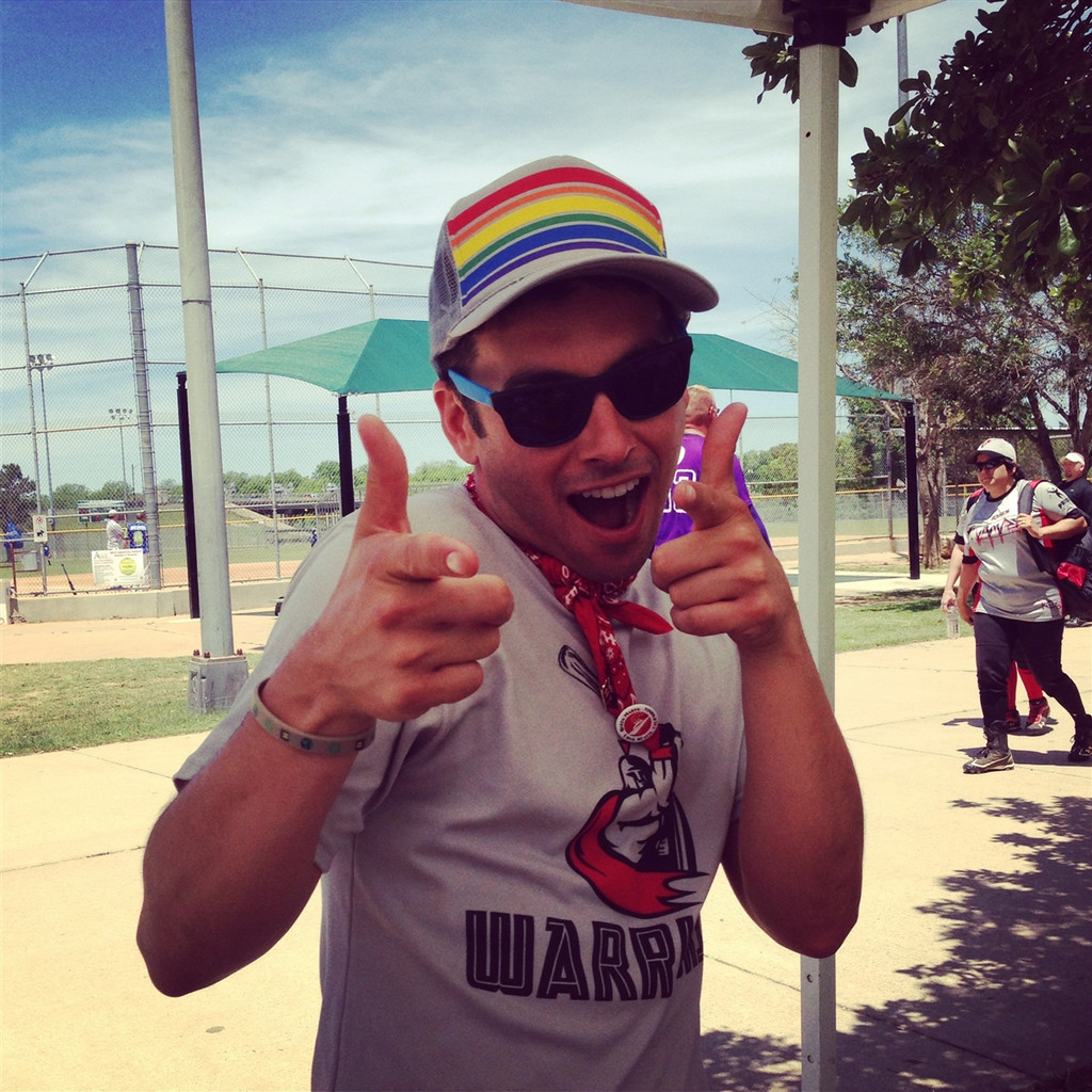hey you!  keep rocking your pride socks rainbow striped snap back while playing softball in austin, tx
