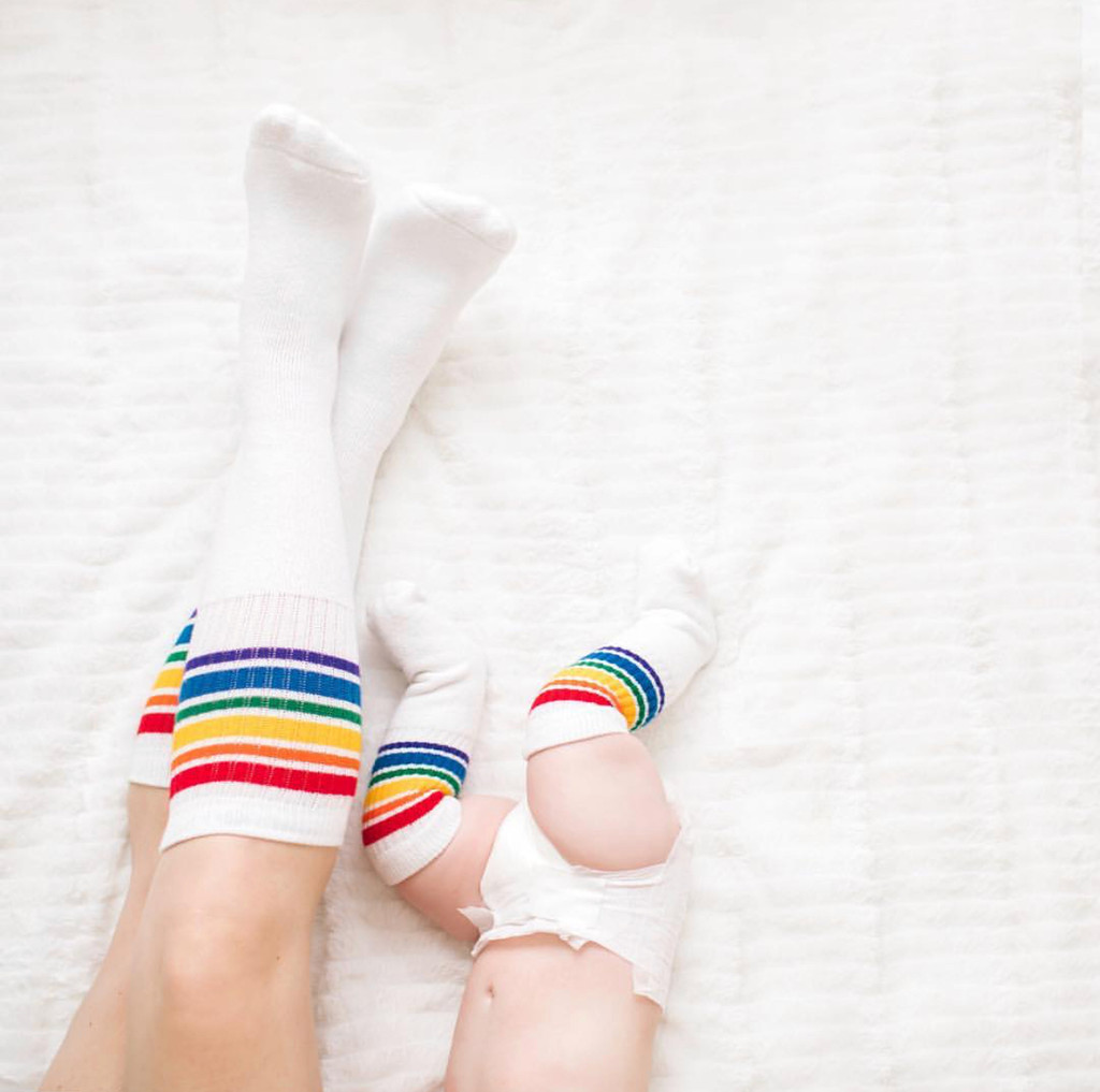 so much love is shared when mom and baby wake up together and match in their rainbow striped tube socks