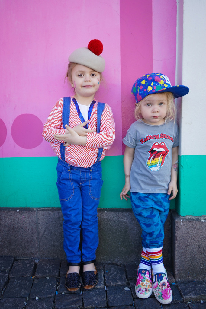 best friends hang out in their creative rainbow striped tube pride socks