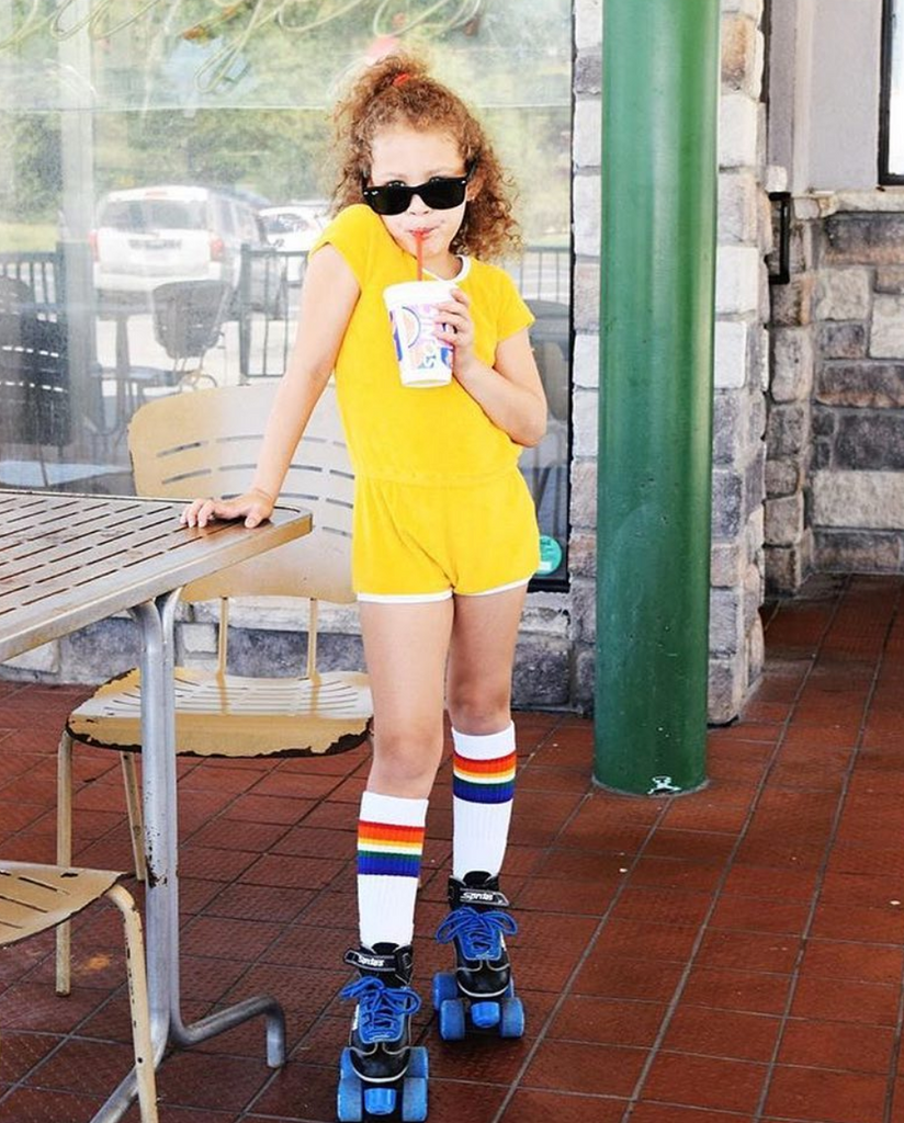 sipping on a coke while owning my retro vibe with my rainbow pride socks