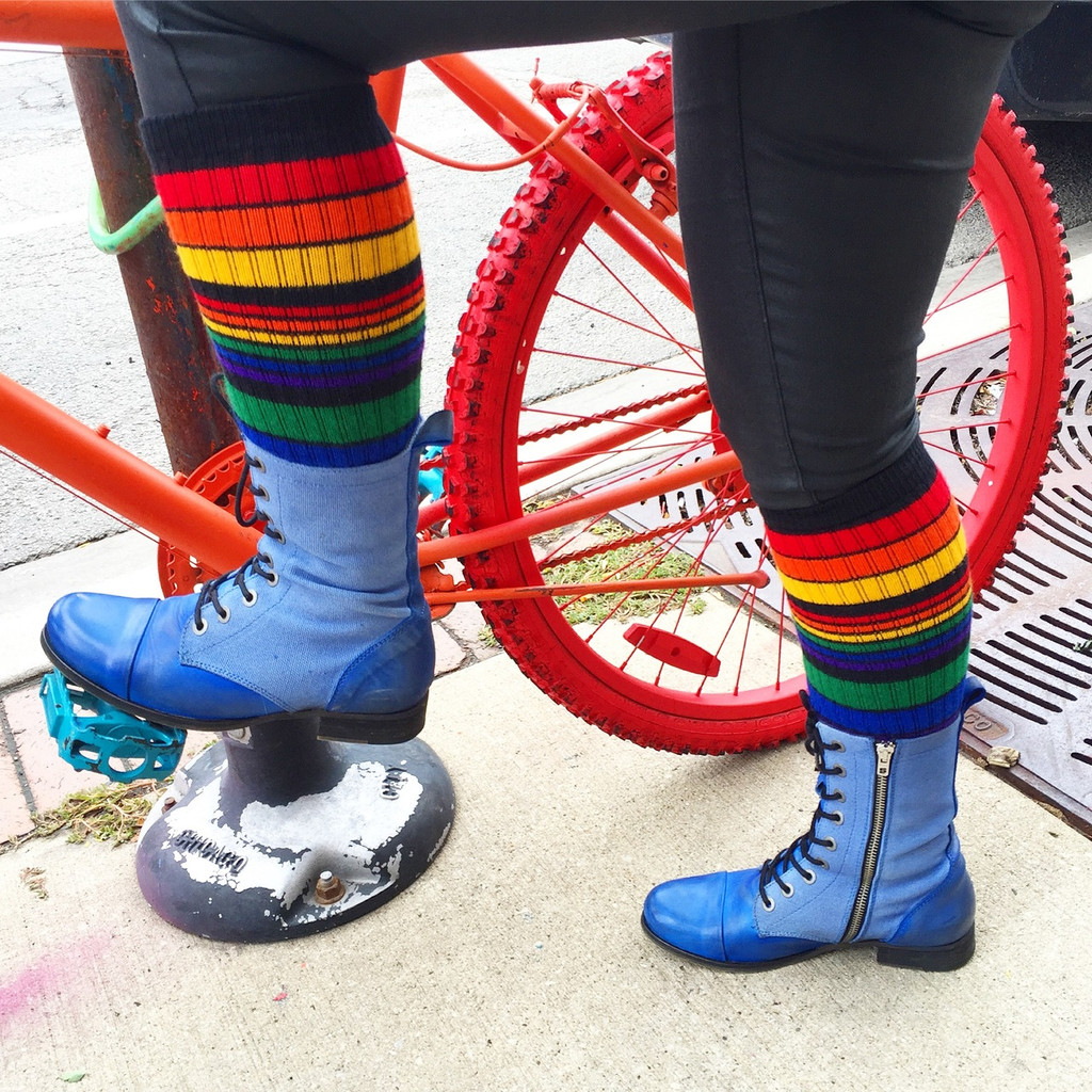 i am a proud cyclist when i wear my black rainbow striped pride socks