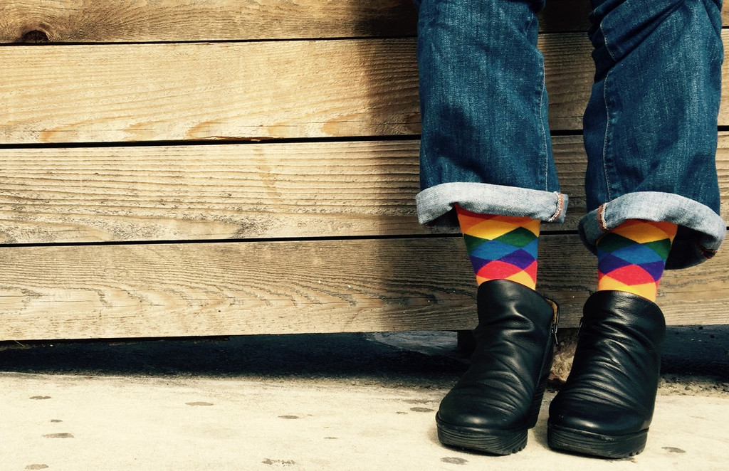 when fashion meets boot socks while wearing rainbow pride argyle socks