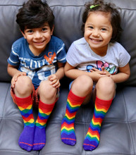 all smiles when we wear matching rainbow socks