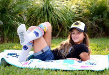 modeling the charity sock for isf in cambodia wearing the skys the limit socks