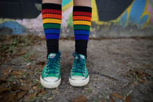 rock out your glow pride socks black rainbow socks to show off your pride.