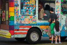 ice cream truck with the family and matching rainbow pride socks