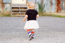 playing in my love toddler rainbow socks.