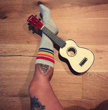 guitar lessons and pride socks are the perfect way to relax.