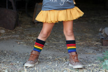 tutus and black rainbow pride socks are two peas in a pod in every childs life