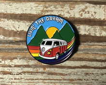 Take your journey in life on any road trip as a reminder to wear your pride socks enamel pin.