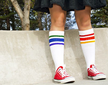 standing tall and proud in my mismatch under the knee rainbow tube pride socks