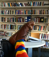 hanging out in the office in my rainbow business socks.