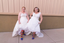 twins getting married with their pride socks