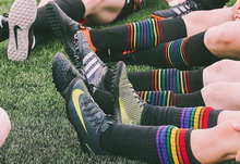 pride socks black rainbow striped compression socks are used to play by pro soccer players