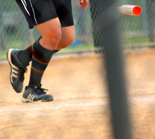 when you play softball, protect your legs with our black rainbow striped compression socks