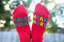 make music mean more pride socks collab with brandi carlile and the looking out foundation