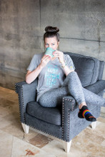 sit back and drink on coffee while you let your rainbow no show pride socks comfort your feet