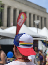 pride socks snap back hat worn backwards