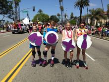 the moxi skate team are rock stars wearing the pride socks in the LA Pride