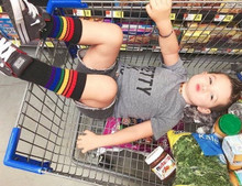 i love when my mom lets me lay out in the grocery cart especially when I am wearing my black pride socks