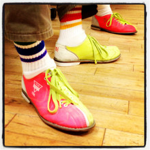 even adults can wear these pride socks when they bowl