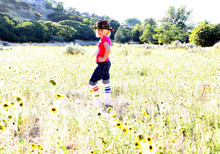 out in the fields modeling while wearing my rainbow mismatch socks