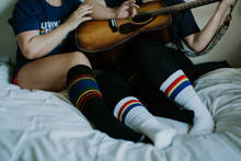 free guitar lessons when i agree to wear matching rainbow tube socks.