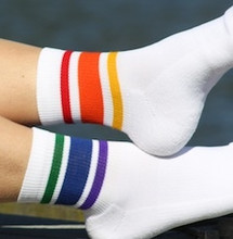 up close and personal with your rainbow striped mismatched athletic moisture wicking pride socks