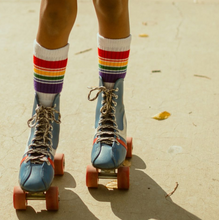 go out and explore with your kid on their retro skates and retro rainbow socks