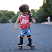 i was feeling brave so i put on my brave rainbow tube socks when i got on this small skate board.  i did it.