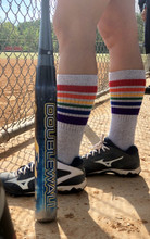 when you play softball make sure to get your gray rainbow striped pride socks