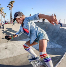 living life to the fullest on her skate board and rocking her pride socks