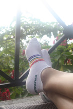 wear your pride socks while you travel across the world and know we will comfort your feet