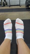 wear rainbow striped no show pride socks to impress your feet.
