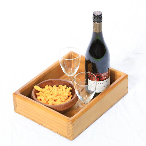 This wooden serving tray with raised sides adds rustic country charm and is a versatile accessory to serve food and drink whether entertaining indoors or outdoors.