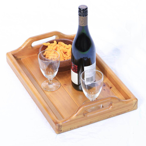 This wooden serving tray with carry handles adds rustic country charm and is a versatile accessory to serve food and drink whether entertaining indoors or outdoors.
