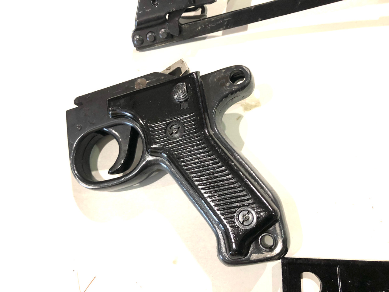 Lot: MG42 grips, cocking handle, and M53 trigger pack