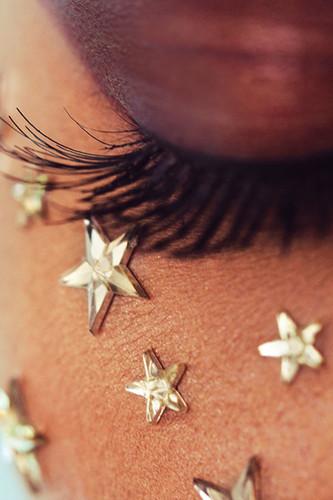 Gold Zorya star face gems