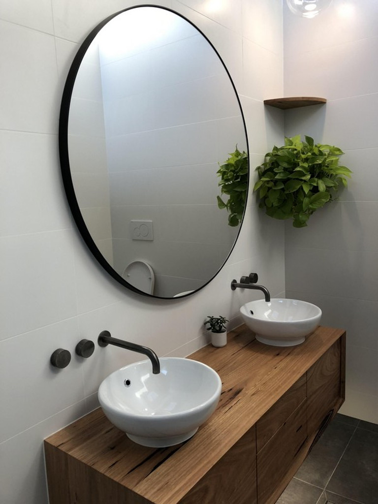 Modern Circular Mirror above double vanity
